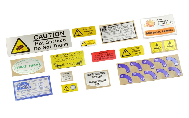 A collection of metal signs and labels