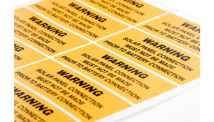 Multiple warning labels in yellow