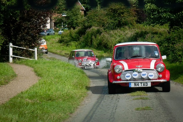 Minis driving along a country road
