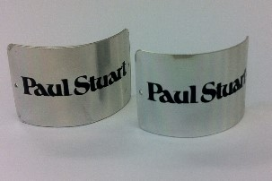 Highly polished anodic aluminium Paul Stuart branded labels