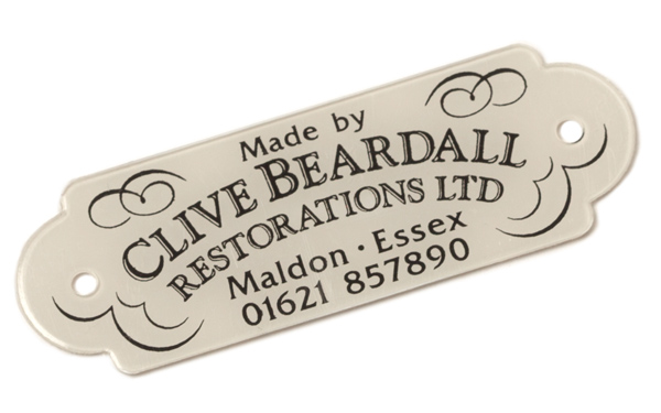 Decorative label 'Made by Clive Beardall Restorations Ltd'